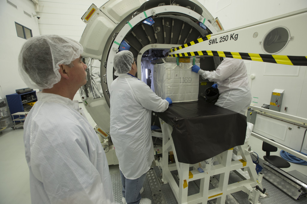 Orbital ATK specialists at NASA's Wallops Flight Facility in Virginia load the Cygnus cargo module with supplies for the International Space Station. Credit: NASA Wallops/Patrick Black