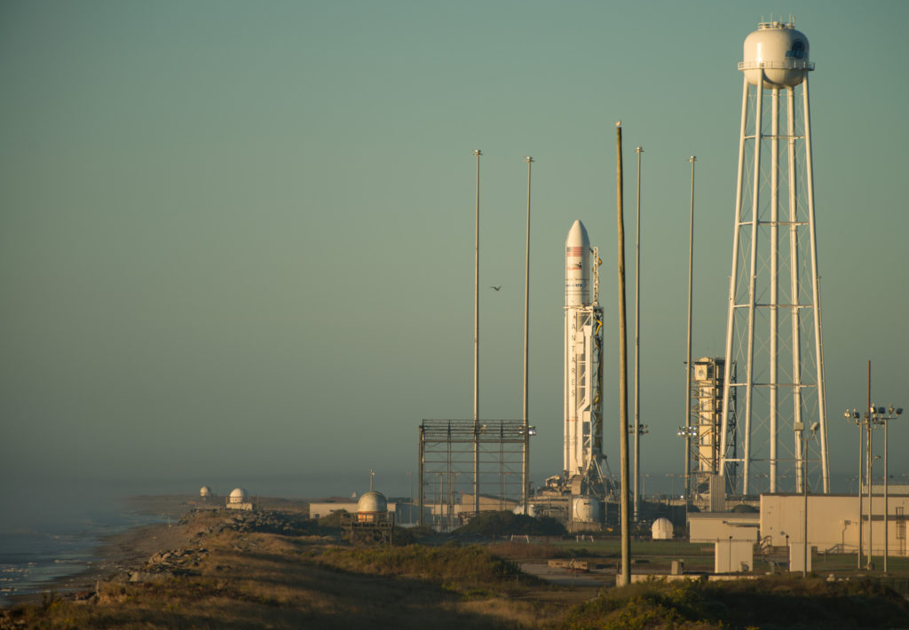 The Orbital ATK Antares rocket, with the Cygnus spacecraft onboard, is seen on launch Pad-0A during sunrise, Sunday, Oct. 16, 2016 at NASA's Wallops Flight Facility in Virginia. Orbital ATK's sixth contracted cargo resupply mission with NASA to the International Space Station will deliver over 5,100 pounds of science and research, crew supplies and vehicle hardware to the orbital laboratory and its crew. Credit: NASA/Bill Ingalls
