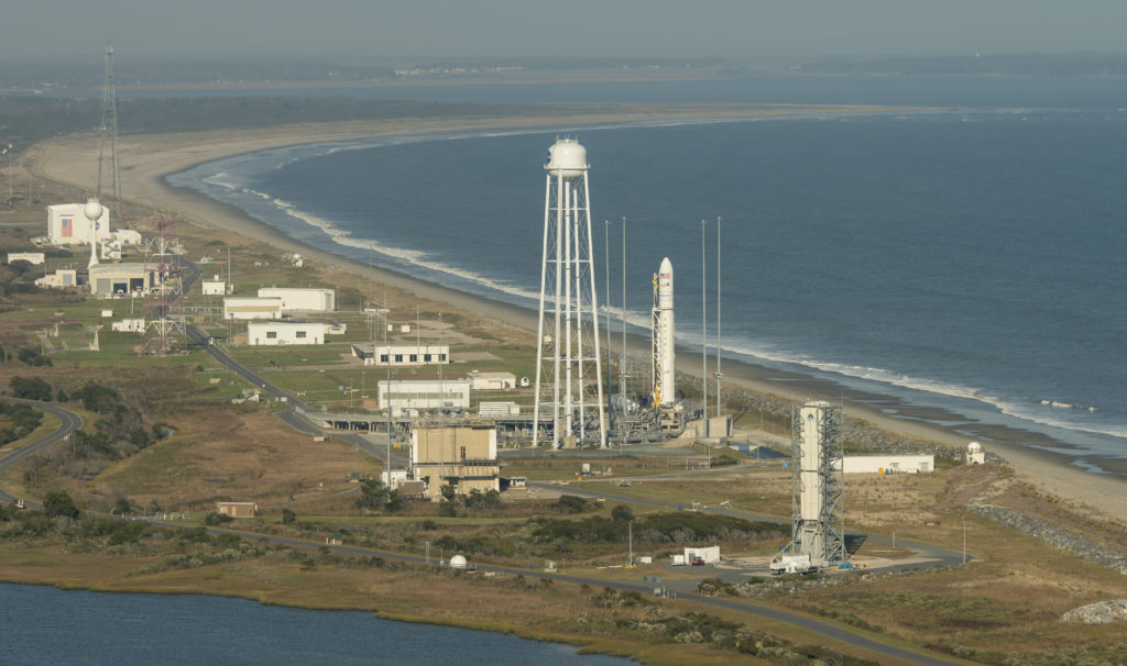 Aerial photograph showing the Orbital ATK Antares rocket, with the Cygnus spacecraft onboard, on launch Pad-0A, Monday, Oct. 17, 2016 at NASA's Wallops Flight Facility in Virginia. Orbital ATK's sixth contracted cargo resupply mission with NASA to the International Space Station will deliver over 5,100 pounds of science and research, crew supplies and vehicle hardware to the orbital laboratory and its crew. Photo Credit: (NASA/Bill Ingalls)