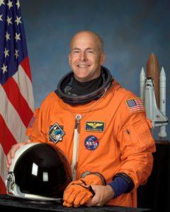 astronaut in orange suit with helmet