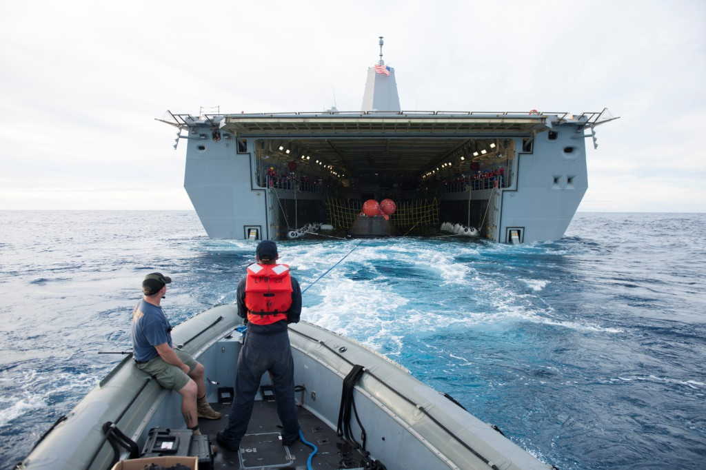 The Orion spacecraft is guided into the well deck of the USS Anchorage during recovery operations following splashdown. Photo credit: NASA