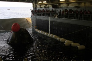 NASA's Orion spacecraft is pulled safely into the well deck of the U.S. Navy's USS Anchorage, following its splashdown in the Pacific Ocean.
