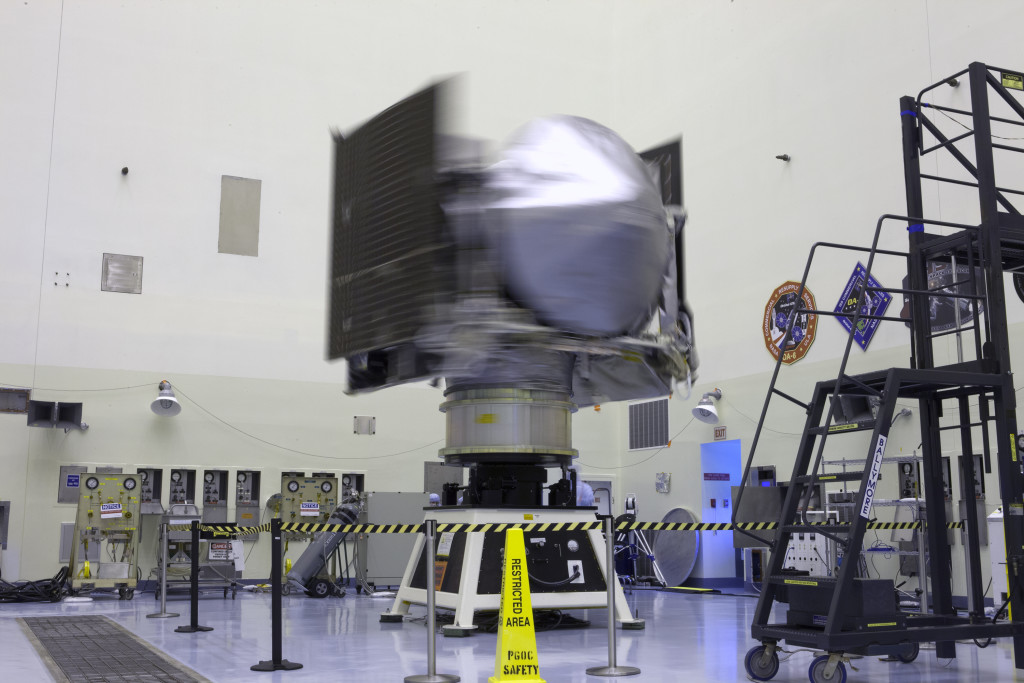A spin test being performed on the OSIRIS-REx inside the PHSF.