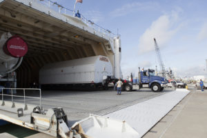 The Port Common Booster Core of the Delta IV Heavy for the Parker Solar Probe (PSP) Mission is offloaded from the Mariner and transported to the Horizontal Integration Facility.