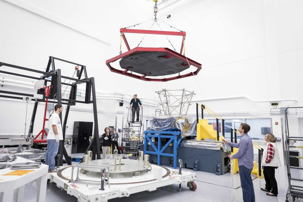Photo of Parker Solar Probe's heat shield being lowered into a shipping container