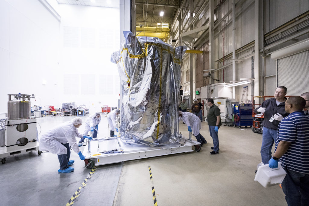 Parker Solar Probe is wheeled into a clean room at NASA's Goddard Space Flight Center.