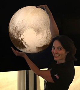 Carly with a model of Pluto