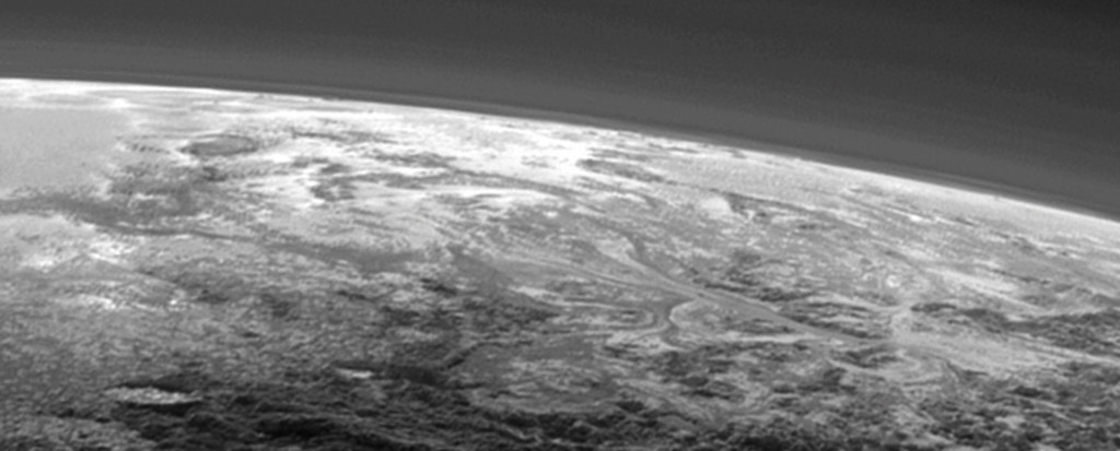 Flow patterns from the lower right of the image, extending to the center of Pluto's informally-named Sputnik Planum.
