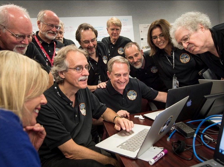 Image of People Surrounding a computer