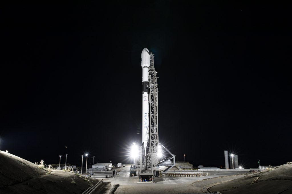 A SpaceX Falcon 9 rocket with Sentinel-6 Michael Freilich in its payload fairing is vertical at the launch pad.