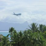 SOFIA landing in French Polynesia with mountains in the background and tropical trees in the foreground