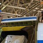 The SOFIA team begins lifting the upper rigid door off the aircraft.