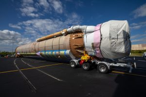 The United Launch Alliance Atlas V booster that will launch the Solar Orbiter spacecraft is delivered by truck to the Atlas Spaceflight Operations Center at Florida's Cape Canaveral Air Force Station on Nov. 21, 2019.