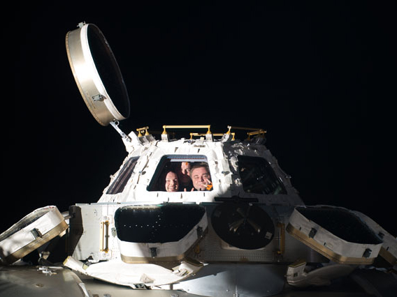 Station Trio Peers out from Cupola