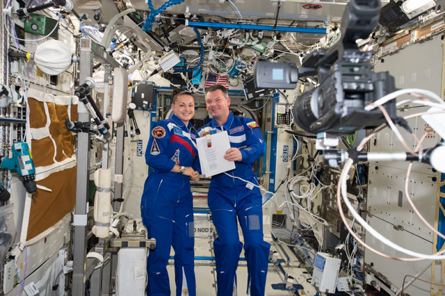 Cosmonauts Elena Serova and Alexander Samokutyaev