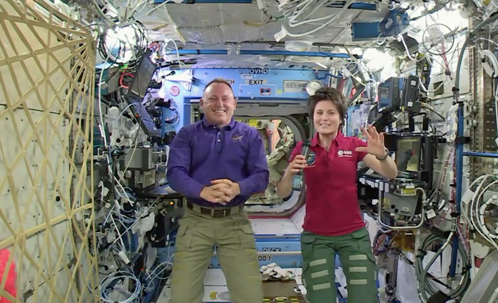Expedition 42 Commander Barry Wilmore and Flight Engineer Samantha Cristoforetti answer questions posed by CBS and BBC reporters on Dec. 30, 2014.