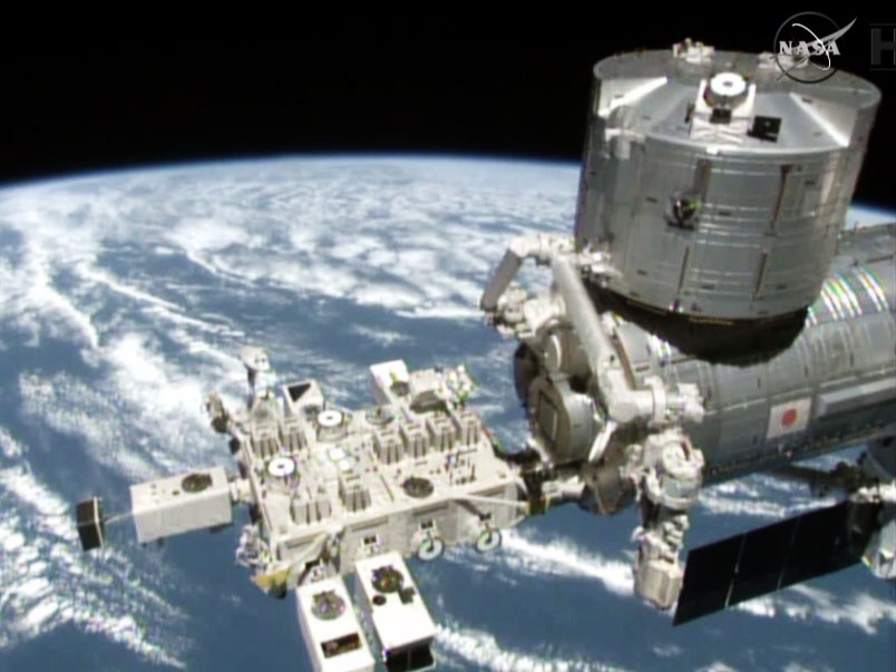 Crew Works Botany and Physics as Robotic Arm Preps New Experiment