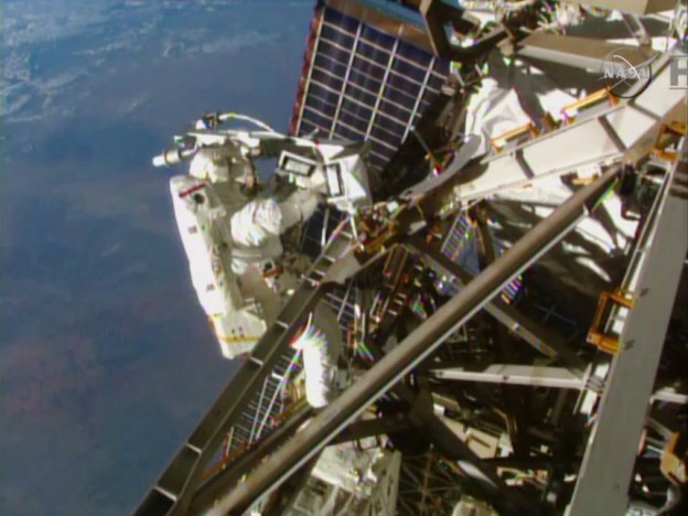 Spacewalkers Install C2V2 Cables