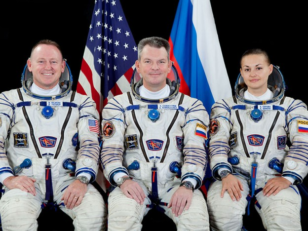 Spacesuit Cleanup Work as Soyuz Crew Preps for Departure
