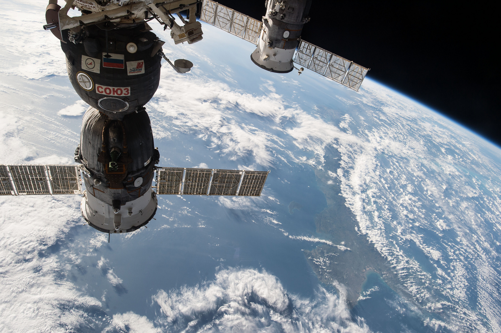 ISS042E101429 (01/05/2014) --- This image, photographed by one of the Expedition 42 crew members aboard the International Space Station, shows the the Soyuz TMA-15M spacecraft on the left attached to the Rassvet module on the Earth-facing port of the Russian segment of the station that delivered Expedition 42 crewmembers Anton Shkaplerov of the Russian Federal Space Agency (Roscosmos), Terry Virts of NASA and Samantha Cristoforetti of the European Space Agency on Nov. 24, 2014 , and to the right, the unpiloted ISS Progress 57 cargo craft that is docked to the Pirs Docking Compartment and which arrived at the station a month earlier on Oct. 29, 2014.