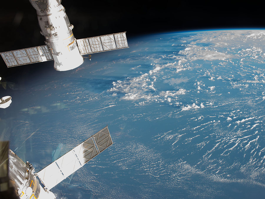 Crew Conducting Human Research and Preparing for Dragon – Space Station