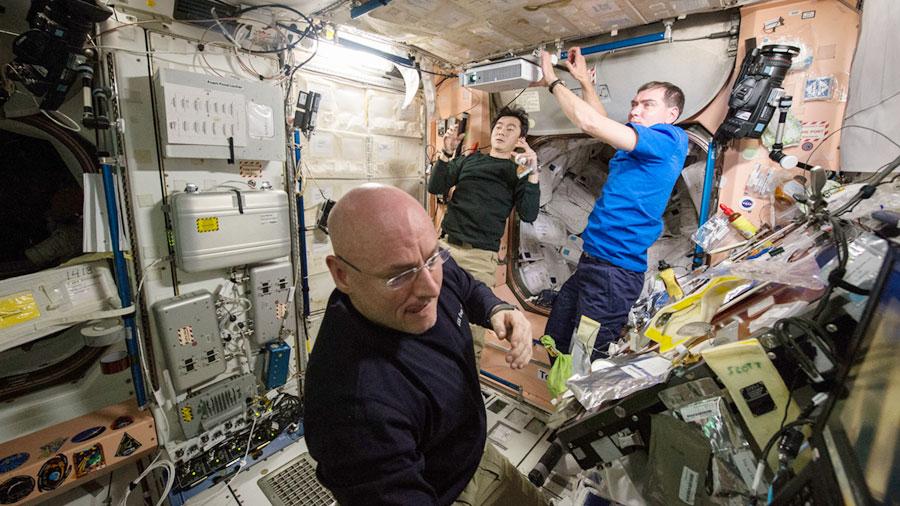 Crew Members Work in Unity Module