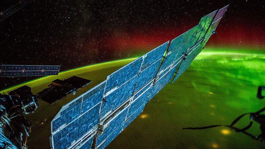 The International Space Station Flies Over an Aurora