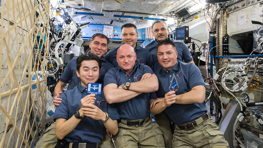 'The Expedition 45 Crew' from the web at 'http://blogs.nasa.gov/spacestation/wp-content/uploads/sites/240/2015/11/iss045e090023_blog.jpg'