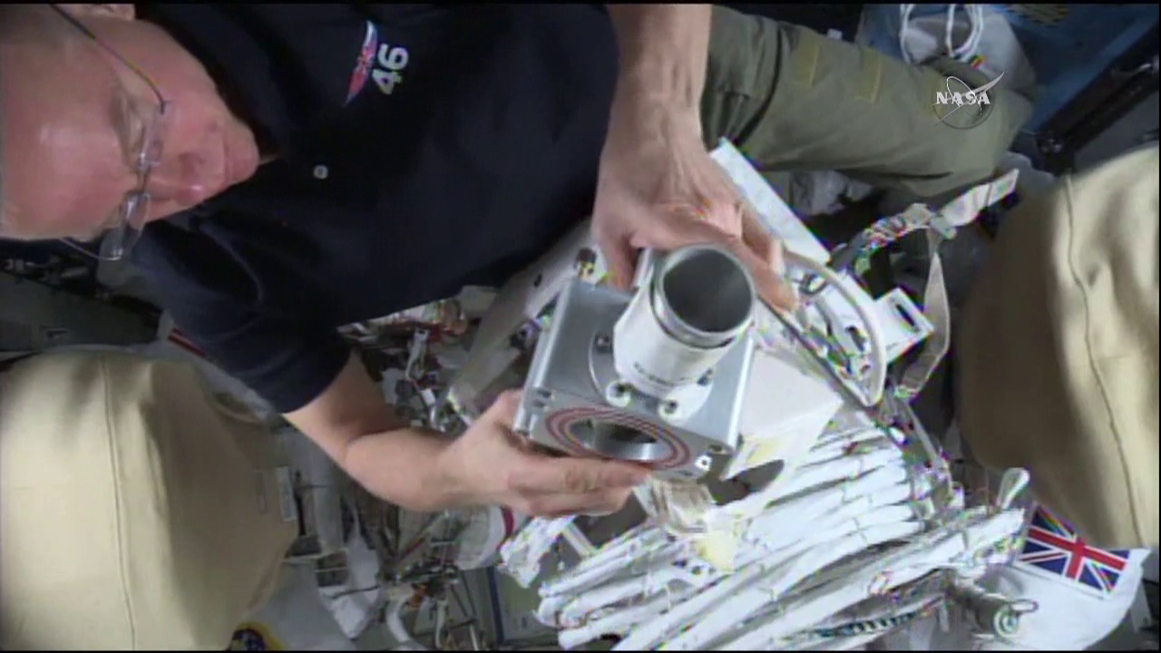 Tim Kopra readies equipment for Friday's spacewalk