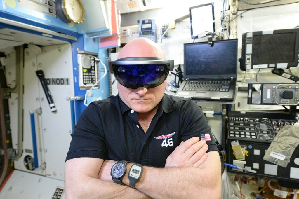 NASA astronaut Scott Kelly performing checkouts for NASA's Project Sidekick, which makes use of Microsoft's HoloLens device.