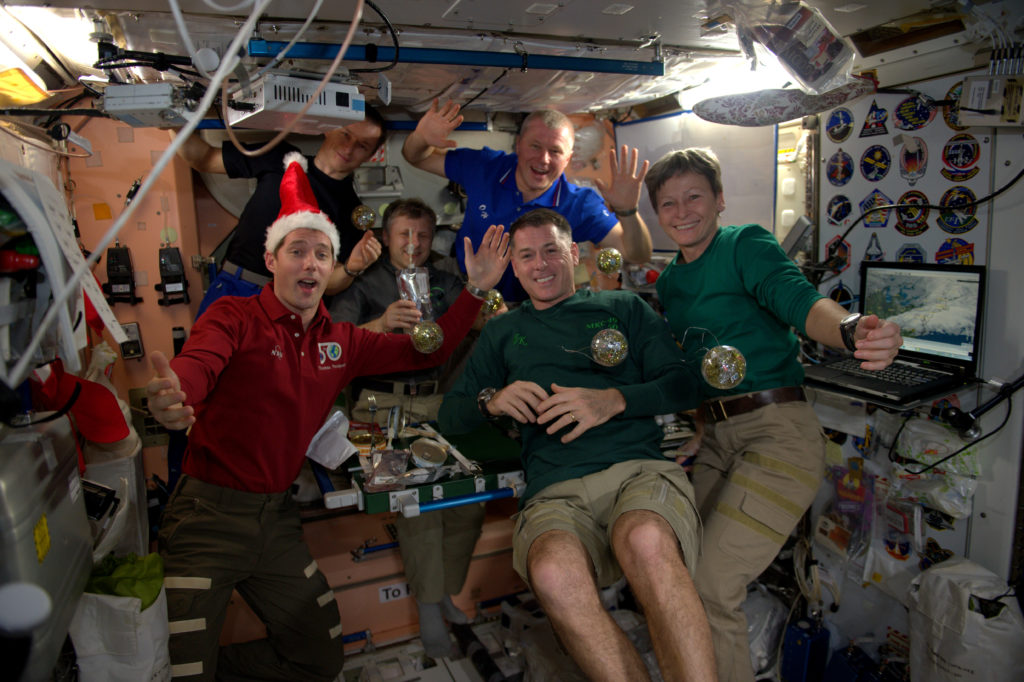 The Expedition 50 crew enjoys an international Christmas dinner aboard the space station.