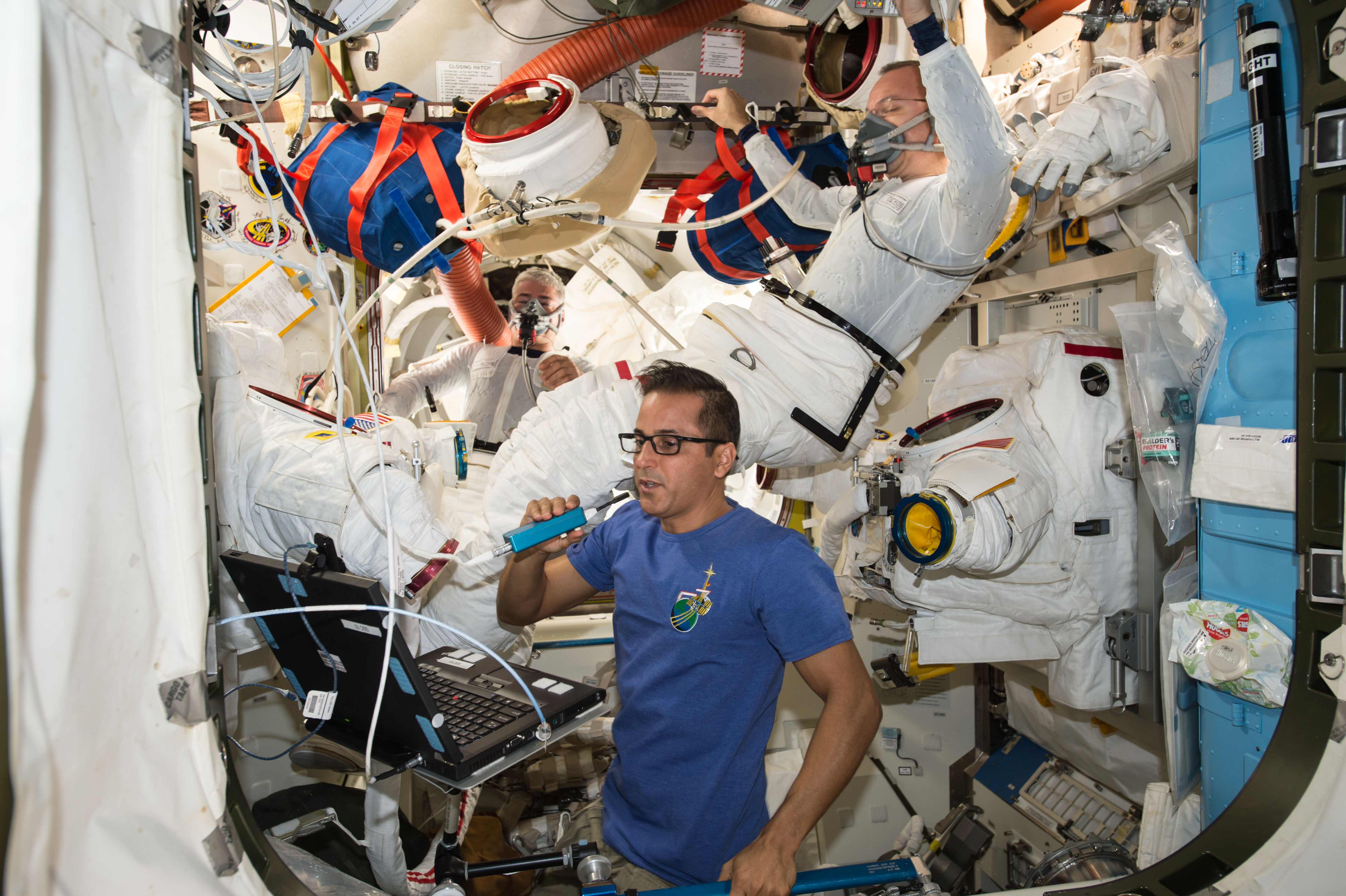 Astronaut Joe Acaba and spacewalkers