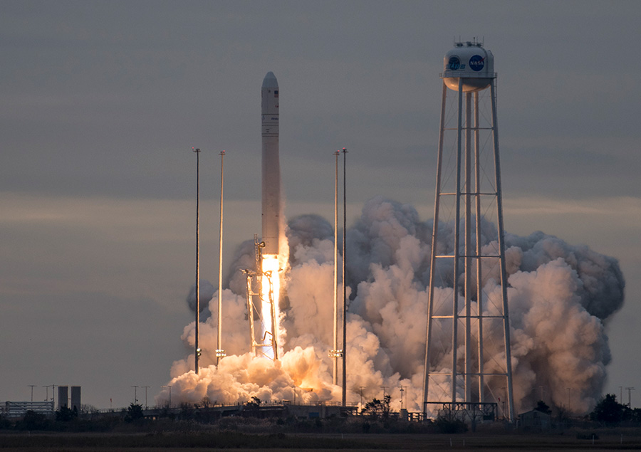 The Antares rocket lifts off with the Cygnus cargo craft aboard
