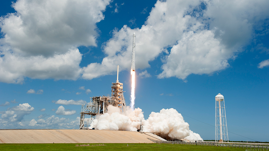 The SpaceX Dragon resupply ship launches atop a Falcon 9 rocket
