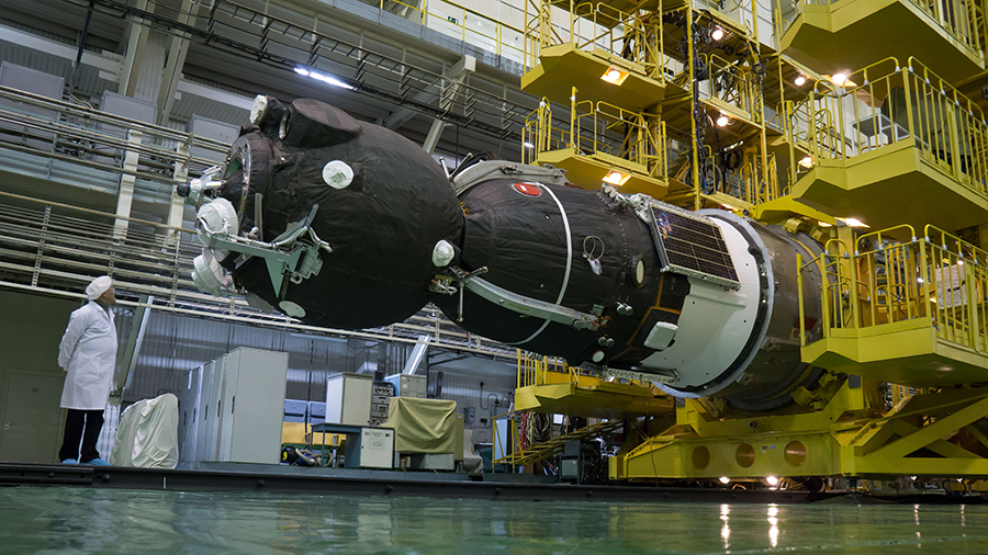 The Soyuz MS-08 spacecraft is rotated to a horizontal position