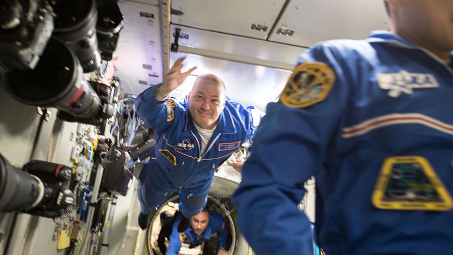 Newly arrived Flight Engineers Scott Tingle and Anton Shkaplerov float into the Zvezda Service Module.