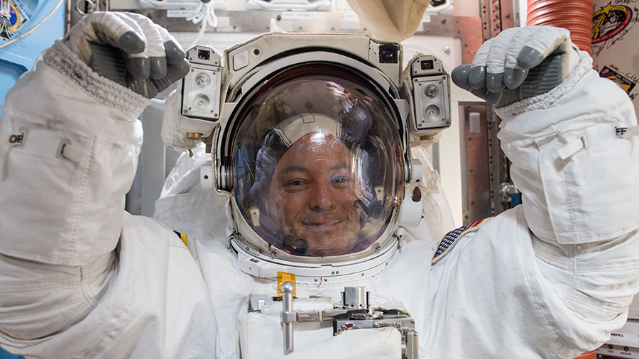 NASA astronaut Scott Tingle prepares for his first spacewalk