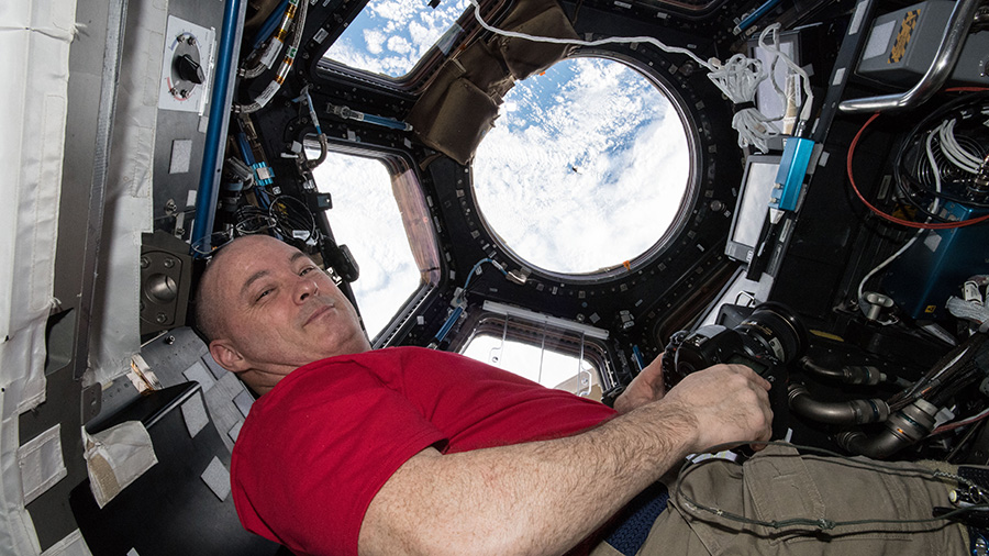 Astronaut Scott Tingle watches the SpaceX Dragon cargo craft arrive