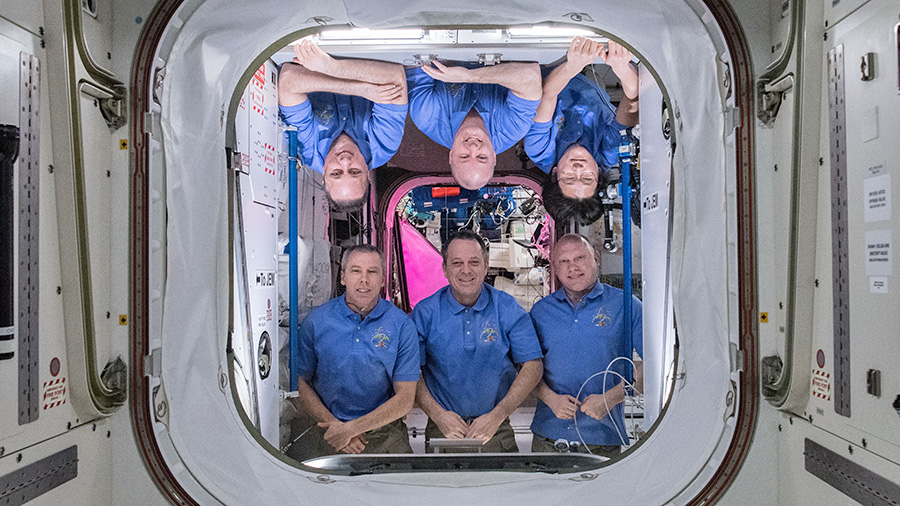 The six-member Expedition 55 crew poses inside the Harmony module