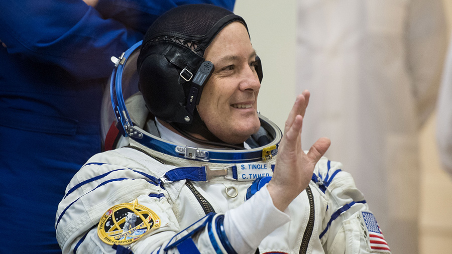 NASA astronaut Scott Tingle waves as he waits