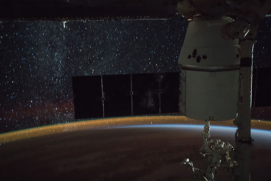 SpaceX Dragon, a star-lit sky and Earth's atmospheric glow