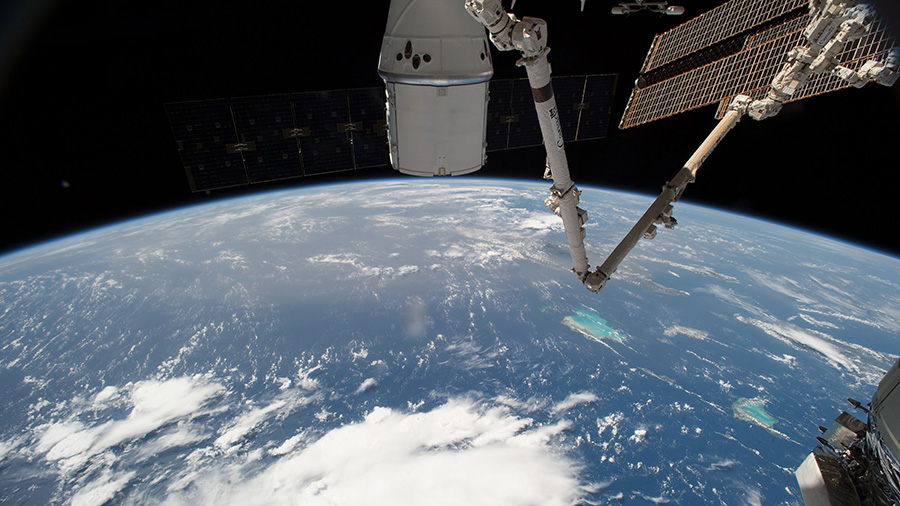 The SpaceX Dragon and the International Space Station orbit above the Bahamas