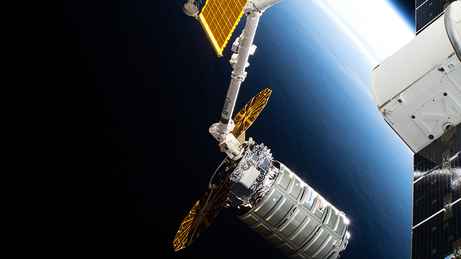 The Cygnus space freighter is poised for release from the Canadarm2
