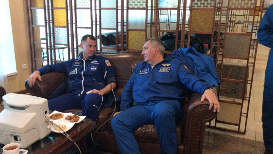 Astronaut Nick Hague and Roscosmos Director Dmitry Rogozin