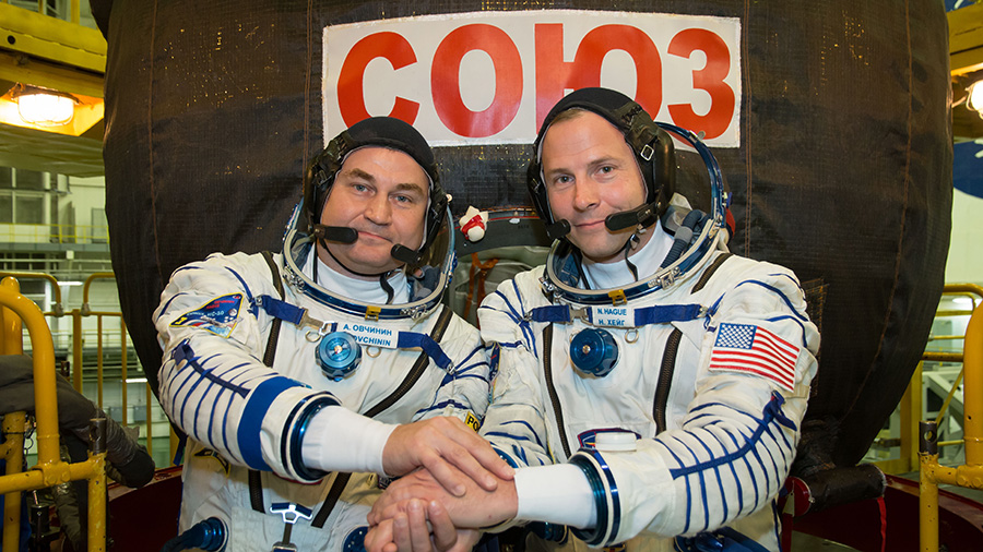 Expedition 57 crew members Alexey Ovchinin of Roscosmos (left) and Nick Hague of NASA