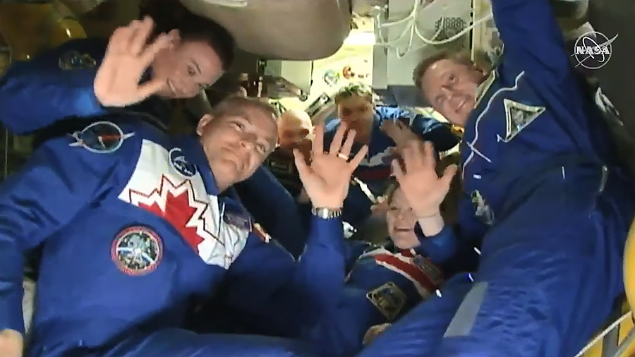 The six-member Expedition 57 crew