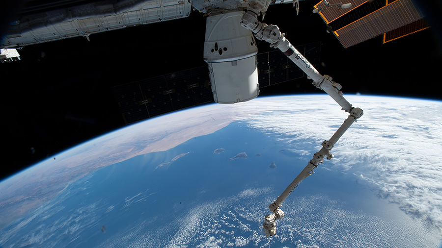 The SpaceX Dragon cargo craft and the Canadarm2 robotic arm