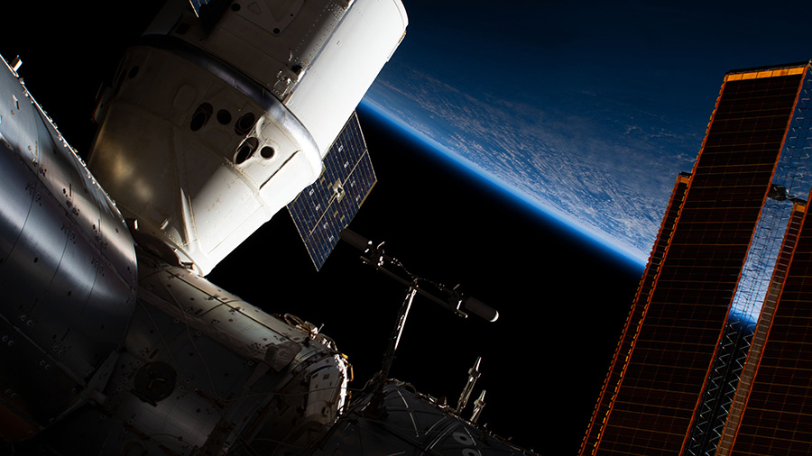 The SpaceX Dragon above Alaska's Aleutian Islands in the Bering Sea