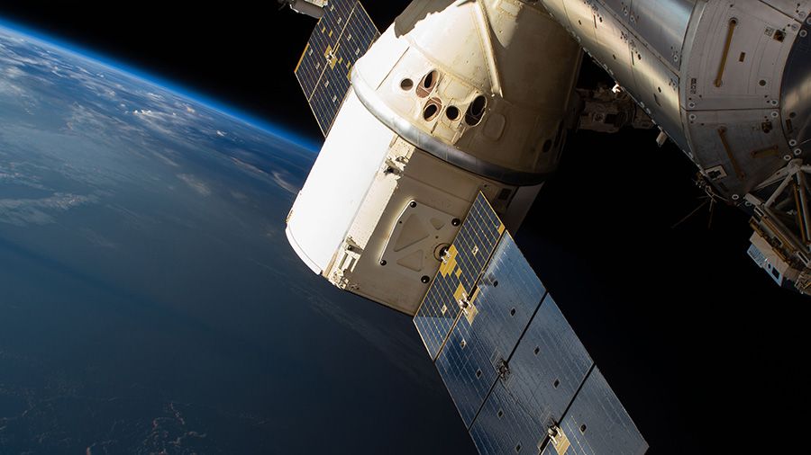 The SpaceX Dragon cargo craft is pictured attached to the International Space Station's Harmony module