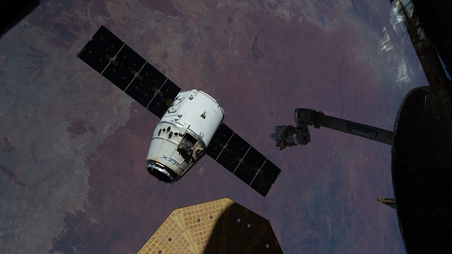 The SpaceX Dragon cargo craft begins its departure